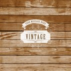 Small 1x vintage label on wooden background